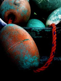 Aqua and Orange ~ Old Fishing Floats by DumpsterDiving1, via Flickr.
