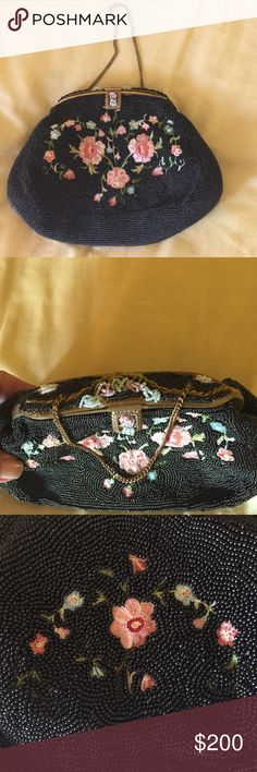 Vintage French Beaded bag This is a collectors piece, absolutely stunning condition of the beading, closure works perfect. Has a few age marks on the inside satin lining due to its age. Firm on this price. Beads are tiny shiny black with pale pink embroidered flowers Bags