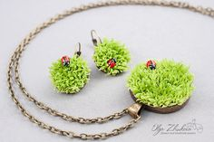 Materials: polymer clay floral, bake polymer clay, metal accessories Size of pendant: 3.5 cm (1.37 inch) , length of chain 60 cm (23.62 inch)