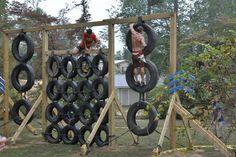 The DIY tire climbing wall. Made from junk yard tires, wood beams, and rope.
