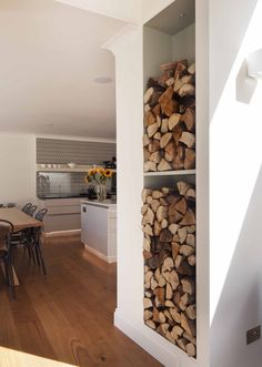 internal Fire wood storage -- i dig how an otherwise unused wall is transformed