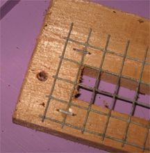 Beehive Mouse Guard : close shot of wire and mounting hole