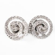 Spiral Diamond Earrings  A pair of stunning diamond earrings in a spiral shape in 18ct white gold. The total diamond weight in these earrings is 0.37ct of H/SI. A matching pendant is available from this collection.