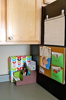 command hooks on side of fridge to hold weekly menu. also like the cork board for pinning 4x6 menu cards, coupons, grocery list, etc.