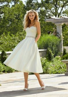 Voyage by Madeline Gardner 6747 Silhouette: A-Line Neckline: Sweetheart Gown Length: Tea Fabric: Taffetas Embellishments: Beading Color: White, Ivory Size: 2 - 28 Price: $