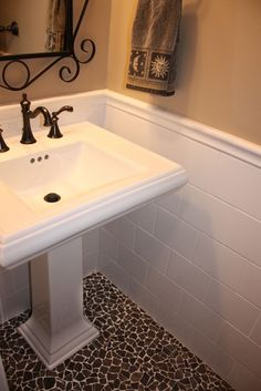 Love the floor!!  Great look for a small powder room