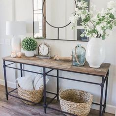 Pieces of reclaimed wood form a richly grained mosaic on this console table. Entryway Console Table, Decorate Console Tables, Console Table Styling, Entry Tables, Console Table With Mirror, Entry Hall Table, Entrance Decor, Entryway Decor, Hallway Table Decor