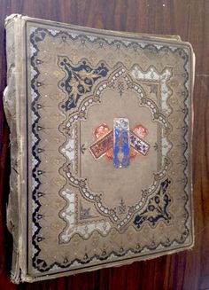 """ANTIQUE 14"""" x 17"""" VICTORIAN DIE CUT SCRAPBOOK ALBUM 83 FULL PAGES  LATE 1800'S ANTIQUE VICTORIAN ERA SCRAP BOOK WITH 83 PAGES OF VICTORIAN DIE CUT CUTOUTS,  CARDS,  ADVERTISEMENTS, SANTAS, ANIMALS, SOME BLACK AMERICANA ETC.   PLEASE EXAMINE PHOTO'S FOR A SAMPLE AND AS PART OF THE DESCRIPTION.  THE BOOK IS 14"""" X 17""""  SOLD $490.00 (2015)"""