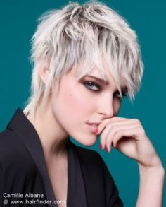 Short women's haircut with elements of the mullet.