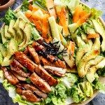 Teriyaki Glazed Chicken Salad complete with avocado, cucumbers, carrots and thin strips of seaweed for real sushi lovers! Drizzled with an incredibly easy teriyaki dressing that doubles as a marinade!   http://cafedelites.com