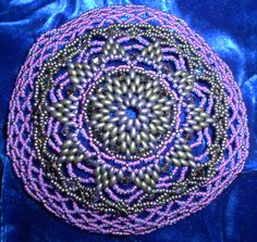 Flower Burst bead woven kippah, done out of Twin Beads and size 11 seed beads.  Now on Exhibit at  The Morris and Sally Justein Heritage Museum in Toronto, Canada