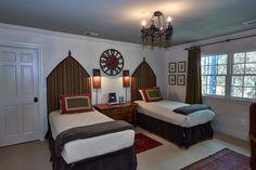 Boys bedroom--custom headboards with metal finials, custom draperies, oushak rug, handmade sconces
