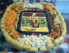 Twinkies, chips and popcorn, dips and cheese, ta-da! Football stadium!  Orig from Flickr