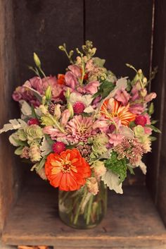 Mid-summer centerpiece with zinnias, lisianthus, dusty miller, gomphrena, snapdragons, and more