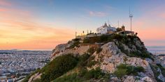 A tourist destination in its own right, the Lycabettus Hill offers spectacular 360° views over the legendary city, all the way to Piraeus and the Saronic Gulf. #Lycabettus #Athens #Attica #Greece #Monterrasol #travel #privatetours #customizedtours #multidaytours #roadtrips #travelwithus #tour #landscape #destination #tourism #sun #sunset #architecture #church #hill #view #panoramic #panorama Athens Hotel, Athens Greece, Attica Greece, Monuments, Architecture Classique, Stuff To Do, Things To Do, Louvre, Seaside Village