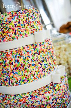 layered white birthday cake with colourful sprinkles for a wedding : )
