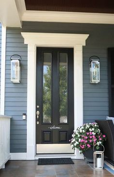 Home Remodeling Exterior Looking to update your curb appeal on a budget? Here are 7 simple and easy ways to update your home's front entry for major curb appeal. Exterior sconce lighting ideas and before after photos. Mesa Exterior, Exterior Doors, Entry Doors, Front Entry, Wall Exterior, Front Door Trims, Ranch Exterior, Craftsman Exterior, Cottage Exterior