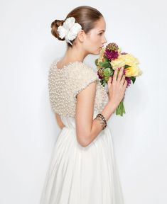 Va Et Vien for BHLDN - Elevate your gown with a luxurious bolero covered in shimmering pearls. Quillaree exclusively for BHLDN. Pearl and sequin bolero, $350, Va Et Vien exclusively for BHLDN. Hair comb, $200, Bride's Head Revisited. Bangles (from left): Topaz crystal, $240, and Swarovski crystals, $175 and $220