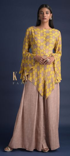 Buy Online from the link below. We ship worldwide (Free Shipping over US$100)  Click Anywhere to Tag Peanut Beige Palazzo Suit With Fancy Bell Sleeves And Asymmetric Cut Hem Online - Kalki Fashion Peanut beige palazzo suit in cotton.Paired with a matching top in knitted cotton with yellow floral print.