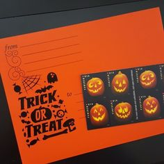 the post office sells jack-o-lantern stamps!