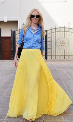 Gorgeous yellow maxi skirt paired with a simple blue shirt.