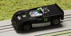 AFX Lola 260 with the rear deck filled in, spoiler added painted and decaled in the Patron Livery