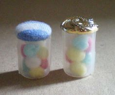 Miniature containers full of cotton balls - good use for opaque tube from pens + button (mage only)   Source: Fabiola's Mini Mondo