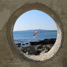 Peep through the hole http://ift.tt/1PwaAJe Black seaBulgariaholeseasummerwindsurfingDuni