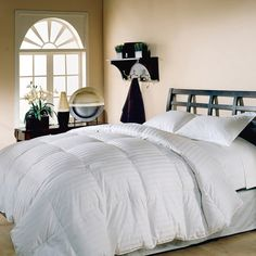 This lightweight 500 thread count down comforter provides blissful slumber. With soft cotton construction, this plush comforter is finished with an elegant cabana stripe. The cover of this beautiful comforter is made from cotton and features a baffle box construction that provides a tailored look. The crisp white shading provides an immaculate appearance, letting you coordinate this piece with any type of bedding, and the comforter is sure to match the furnishings and decor in your home.