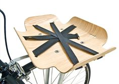"""Up until now, the bike basket has been entirely lame. Now, all of that is changed. Yes, this is the """"Bent Wood Basket."""" Made with light carmel wood and black nylon straps. Simple and fabulous."""