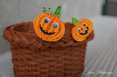 Quilled pumpkins in a basket