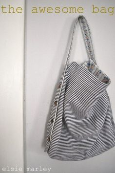 DIY bag! you can change the strap length- and it's reversible!  This is so fun...I love bags.
