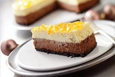 A layer each of orange and chocolate cheesecakes are sandwiched between a cookie crust and a marmalade glaze. It'll get 32 thumbs up! (Serves 16.)