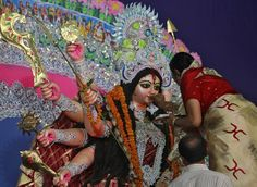 A devotee offers sweets to an idol of the Hindu goddess Durga while offering prayers on the last day of the Durga Puja festival in Allahabad, India. The Durga Puja festival is the biggest religious event for Bengali Hindus. Hindus believe that the goddess Durga symbolises power and the triumph of good over evil. (Photo by Jitendra Prakash/Reuters)
