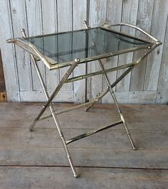 Vintage French metal faux bamboo serving tray and stand.
