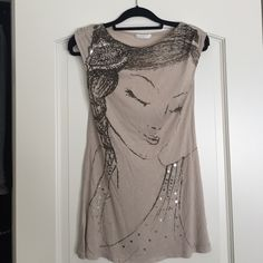 Top with design Brand New--Long beige top with a girl's face on it. Sequin details. Promod Tops Tees - Short Sleeve