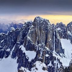C4 director @timkemple photo // Life is filled with tough choices... Like which one of these bad boys do you want to climb? This is a birds-eye view of the elusive Kichatna Spires in Alaska -- they probably see twice as many days in the clouds as they do the sun in a given season... #camp4pix @phaseonephoto @denalinps