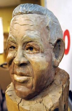 This finished bust is of his dad that he carved into a log.  Herman Davis, a local woodcarver and story teller, was at the Beaumont Public Library Downtown branch this week, demonstrating his art of carving all types of wood, and telling his folk stories during a program for adults. He brought with him several large examples of carving that he has finished as well as continues to carve on.   Dave Ryan/The Enterprise