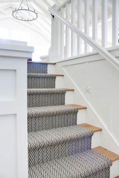 Vintage Home Herringbone stair runner - Oar rack wall decor. Board and batten walls, white oak flooring and chippy vintage oars on oar racks. Oak Stairs, House Stairs, Basement Stairs, Open Basement, Cottage Stairs, Basement Ideas, Garden Stairs, Carpet Diy, Stairs