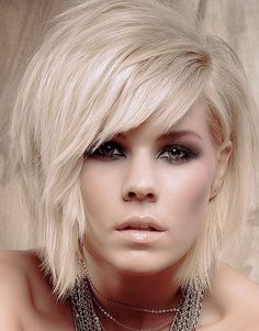 Amazing side fringe. I'd DEFINETELY have my hair that  style and cut. I might have the colour but a black would look stunning. As for red or dark brown.