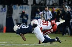 PENN STATE – FOOTBALL 2013 – ROBINSON reaches around defender to haul in 43-yard pass from Hackenberg.