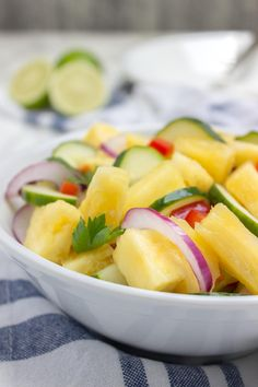 Jucy and refreshing Pineapple Cucumber Salad is a super HEALTHY way to cool down this summer! This salad is easy to make, bursting with fresh summer flavors and full of nutrients. Perfect side for summer BBQs and parties! #summer #BBQ #picnic #party #glutenfree #vegan #salad #healthy #lowcalorie #weightloss #fit #kidsfriendly | natalieshealth.com