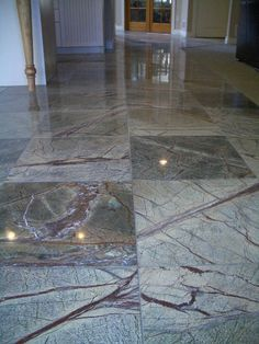 Chapter 7. This is a modern floor tiled with colored marble. The Byzantines used floors tiled with colored marble, but they often used geometric designs. This is a more contemporary example of how we tile a marble floor today.http://tileartcenter.com/wp-content/gallery/rainforest_green_marble/cimg4666.jpg