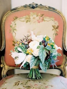 Beautiful, one-of-a-kind Bridal bouquet with lush flowers and exotic greenery. #wedding #flowers