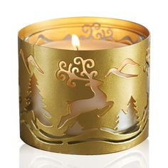 """AVON EXCLUSIVECutout reindeer design in a goldtone finish. Fits Avon's Holiday 11 oz. candle jars (sold separately). 4 1/3"""" diam. x 3 1/3"""" H. Metal. Imported."""