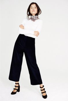 CLUB MONACO NOVEMBER NEW ARRIVALS STYLED AND WORN BY ANNA GRAY. WEARING CAROLENA TOP, SHINEADE CORDUROY PANT, AIRLIA SILK SCARF, YUULIA THREE-STRAPPED HEEL