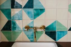 Bathroom: brass faucet with a backsplash of hand-painted blue and green tile. Wall And Floor Tiles, Wall Tiles, Kitchen Tiles, Kitchen Paint, Kitchen Decor, Kitchen Design, Sullivans Island, Brass Faucet, Stylish Beds