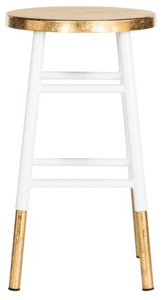 A classic silhouette gets an on-trend update in the Elise Counter Stool, an eclectic addition to any kitchen island or home bar. The stool's chic white lacquer is set off by its gold-dipped legs and s