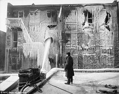 Fire and ice: A man looks on at the mounds of frozen icicles following the FDNY extinguished a building fire in December 1917