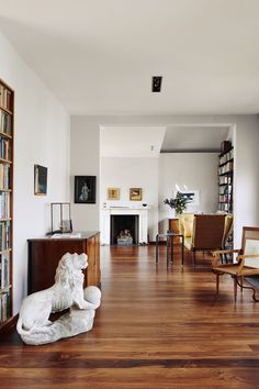 "[i]The livng room is decorated in a simple elegant style with white walls and wooden floors.[/i]  Like this? Then you'll love  [link url=""http://www.houseandgarden.co.uk/interiors/white-room-ideas""]White Room Ideas[/link]"